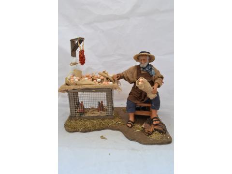 Venditore di uova seduto - Movimento - 24 cm